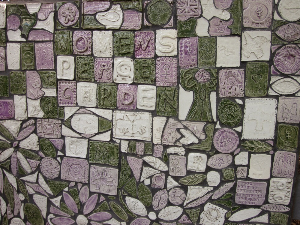 Pass by the mosaic, in the women's movement colours of green, purple and white