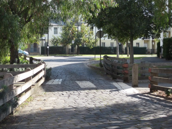 The road narrows so that cars have to give way to pedestrians (Photo copyright: Anne Lawson)