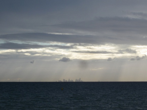 The high rise building of Melbourne, across the showery Bay. (Photo copyright: Anne Lawson 2013)