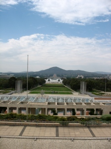 Looking, from the top of Parliament House, down to the Old Parliament House, across the lake, to the War Memorial. (Photo copyright: Anne Lawson 2009)