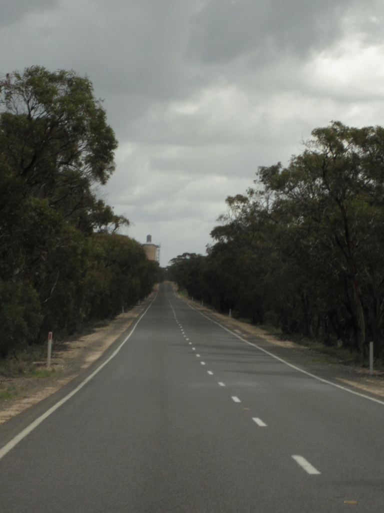 Mallee Country -- flat road and a wheat silo. (Photo copyright: Anne Lawson 2013)