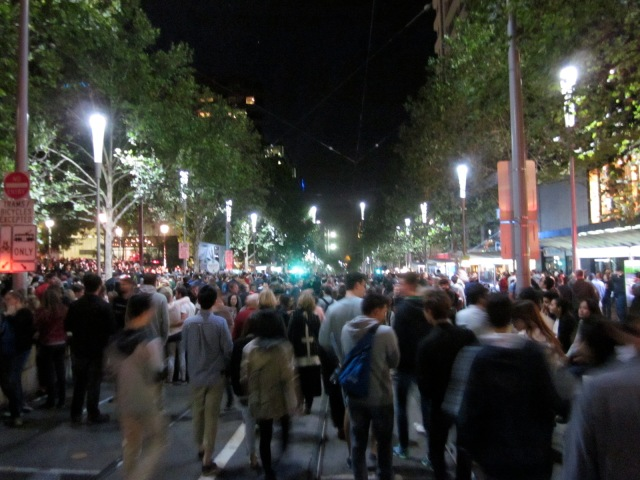 Crowds down Swanston St ~ and it just got thicker and thicker! (Photo copyright: Anne Lawson, 2014)